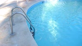 urvat : Grab bars ladder in swimming pool at poolside
