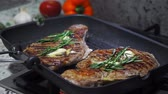 ribeye : Cooking beef on grill frying pan on gas oven Stock Footage