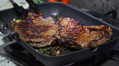 bonfile : Cooking beef on grill frying pan