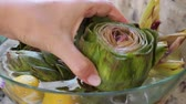 carciofo : Woman take artichoke from glass bowl
