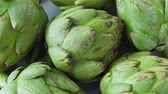 devedikeni : Whole fresh artichokes on plate