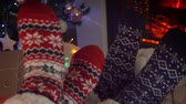 양말 : Couple in woolen socks near fireplace in living room decorated for Christmas holidays 무비클립