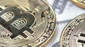 filare : Bitcoins on dollar banknotes background, closeup