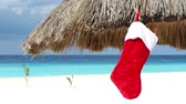 babbo natale : Christmas stocking sock on sun umbrella at caribbean beach