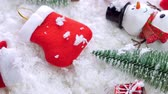 babbo natale : Different christmas objects lay out on snow background Filmati Stock