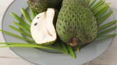 trottola : Closeup of green soursop graviola, exotic, tropical fruit Guanabana on plate