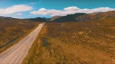 jaro : Flying over the lonely road in the mountains