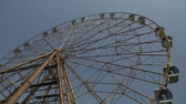 The Ferris wheel is spinning in an amusement park