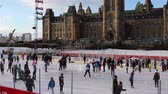 bayrak : Ottawa, Ontario, Canada - January 20th, 2018: People Ice Skating on Parliament Hill with Flag closeup at the end