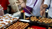 quibe : Takoyaki cooking on hot pan. People grilling takoyaki for serve customer. slow motion and smooth view point.