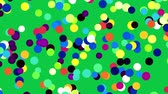 rebuliço : Colorful spots randomly fill classic green screen background.