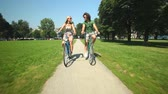 fitness : Young couple enjoying cycling through park in summer