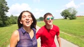 blading : Young woman and man rollerblading on a beautiful sunny summer day in park, hugging each other. Stock Footage