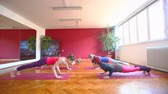 cobra : Group of attractive women doing yoga on rubber mats in hall Stock Footage
