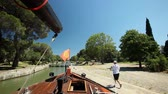 navigation : CANAL DU MIDI, FRANCE - JUNE 22: Boat in lock on June 22, 2013 on the Canal du Midi, France. The UNESCO listed canal was built in 17th century stretching from Toulouse to Bezier. Stock Footage