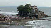 tanah lot : BALI - MARCH 10. Pilgrims at Tanah Lot on March 10, 2012 in Bali, Indonesia. Most Balinese hindus come to the temple on the sea as a spiritual experience.