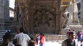 Махараштра : AURANGABAD, INDIA - 14 JANUARY 2015: Relievo on the wall of Aurangabad caves, with people passing.