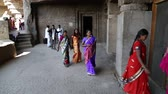 Махараштра : AURANGABAD, INDIA - 14 JANUARY 2015: Tourists passing through the halls of Aurangabad caves.