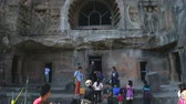 Махараштра : MUMBAI, INDIA - 15 JANUARY 2015: Tourists in front of one of entrances to Aurangabad caves. Стоковые видеозаписи