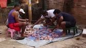 junco : GOA, INDIA - 23 JANUARY 2015: Men sorting meat of slaughtered animal.