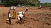 černoch : GOA, INDIA - 26 JANUARY 2015: Men and women working at the field working site digging soil.