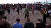 djembe : GOA, INDIA - 19 JANUARY 2015: People dancing on a sandy beach to the music played by djembe band.