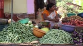 artesanato : GOA, INDIA - 20 JANUARY 2015: Woman at market stand with vegetable in Goa.