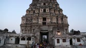 art : HAMPI, INDIA - 28 JANUARY 2015: View of temple Virupaksha and tourists in Hampi.