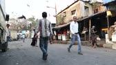 não higiênico : MUMBAI, INDIA - 8 JANUARY 2015: People walking through the busy market street in Mumbai.