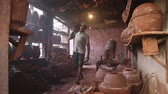 crock : MUMBAI, INDIA - 12 JANUARY 2015: Indian men in clay workshop in Mumbai.