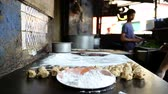 naan : MUMBAI, INDIA - 12 JANUARY 2015: Flour on the table and Indian men preparing local food in Mumbai.