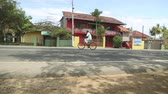 srilankan : WELIGAMA, SRI LANKA - MARCH 2014: Man on a bicycle nearly getting knocked over on street of Weligama. Cycling is the cheapest way of transport in the country. Stock Footage