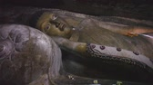 meditation : DAMBULLA, SRI LANKA - FEBRUARY 2014: Tracking shot of sleeping Buddha at the Golden Temple of Dambulla, a World Heritage Site in Sri Lanka. Stock Footage