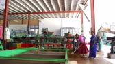 quarto : NUWARA ELIYA, SRI LANKA - MARCH 2014: View of a four local women working on a machine in the tea factory in Nuwara Eliya. Sri Lanka is the worlds fourth largest producer of tea.