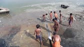 mangueira : VARANASI, INDIA - 25 FEBRUARY 2015: Group of boys playing with water from hose by Ganges river.