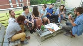 baloon : High angle view of young friends eating pizza on the rooftop terrace