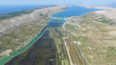 saltworks : Aerial view of salt pans surrounded by sea and mountains of Pag island, Croatia