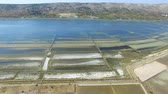 saltworks : 360 view of salt pans surrounded by sea and mountains, Pag island, Croatia