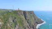 Sea view of lighthouse at Cabo da Roca cape, westernmost extent of mainland Portugal and continental Europe. 影像素材