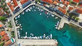 Aerial view of small harbour with moored boats in the Adriatic 影像素材