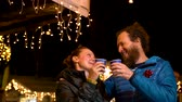 süsleme : Couple enjoying traditional drink at Christmas market, Zagreb, Croatia.