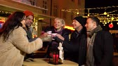 mulled : Group of friends chating at Christmas market, Zagreb, Croatia. Stock Footage