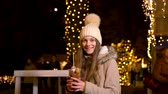 Cute teenager holding traditional food at Christmas market. Zagreb, Croatia Stock Footage