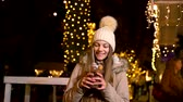 Amazed teenager holding traditional food at Christmas market. Zagreb, Croatia.