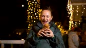 Woman holding traditional food at Christmas market. Zagreb, Croatia Stock Footage