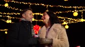 mulled : Couple talking at Christmas market. Zagreb, Croatia. Stock Footage