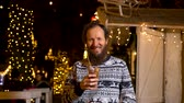 Happy man holding traditional fritula at Christmas market. Zagreb, Croatia Stock Footage