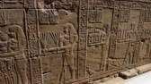 ancient egypt : Hieroglyphic carvings on an ancient egyptian temple wall