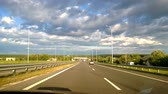 from the car passenger front POV view picturesque landscape with meadow field sky and clouds