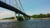 river trip on a boat under the bridge picturesque banks coast of Dnipro river at Kyiv Ukraine